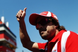BARCELONA, SPAIN - MAY 22:  Fernando Alonso of Spain and Ferrari attends the drivers parade before the Spanish Formula One Grand Prix at the Circuit de Catalunya on May 22, 2011 in Barcelona, Spain.  (Photo by Vladimir Rys/Getty Images)